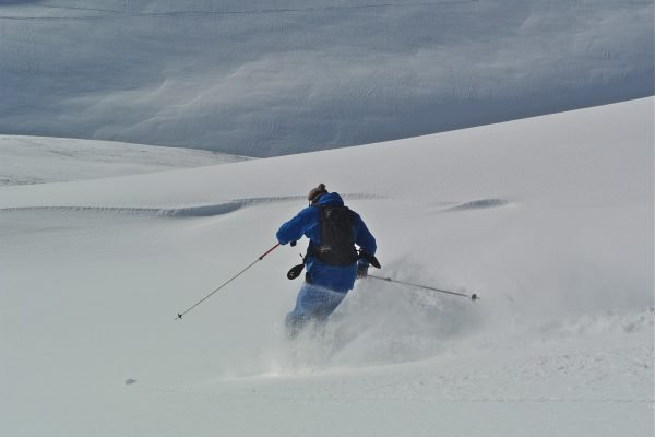 off piste powder hat ski group